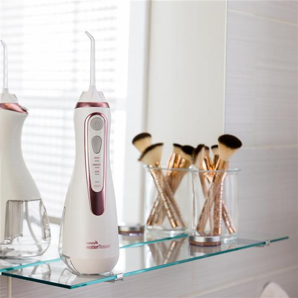 White & Rose Gold Cordless Advanced Water Flosser WP-569 In Bathroom